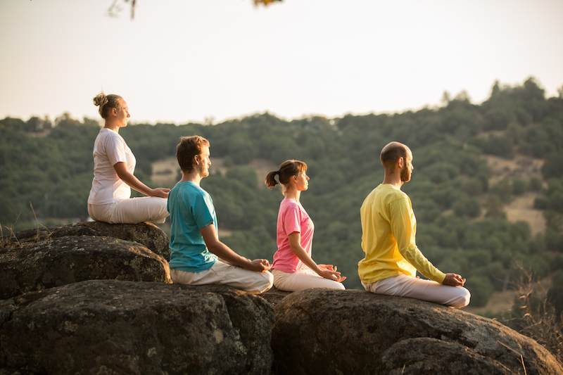 Group of students meditating on Siva Hill