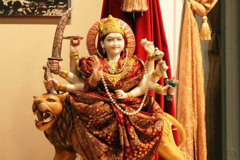 Durga Devi marble statue riding on lion